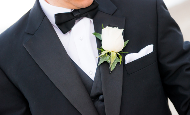 Classic tux and white rose