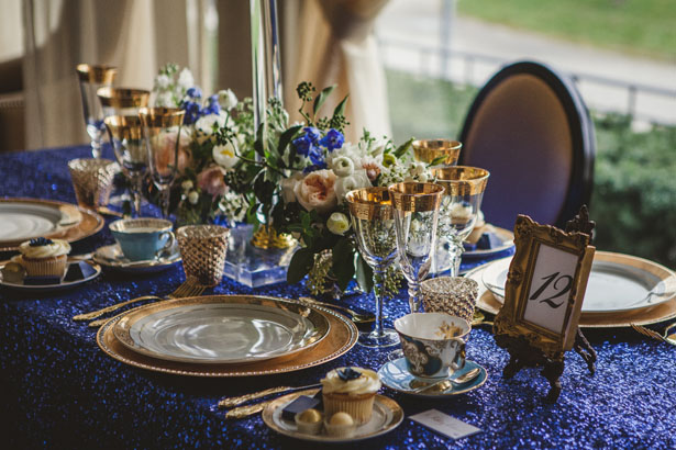 Vintage meets glam wedding inspiration belle the magazine royal blue and gold table decor junglespirit Images