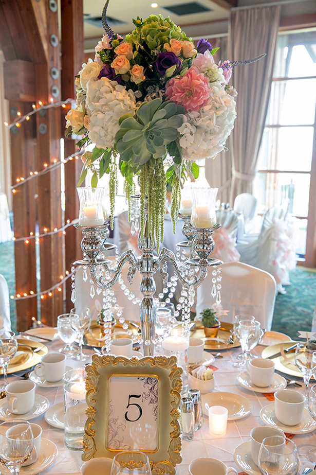 Candelabra and succulents wedding centerpiece