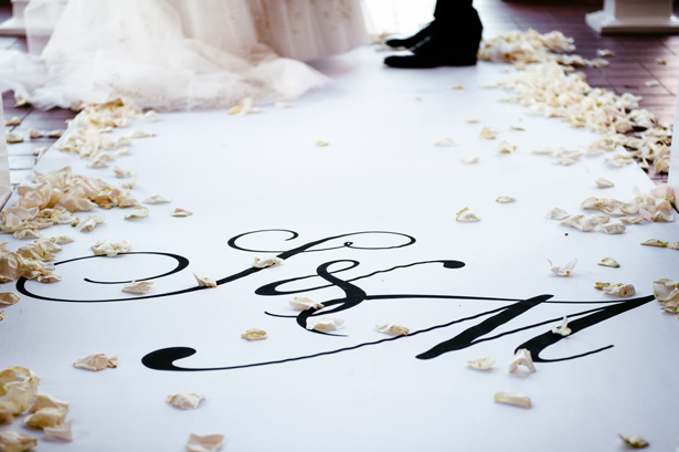 Monogramed wedding aisle and petals