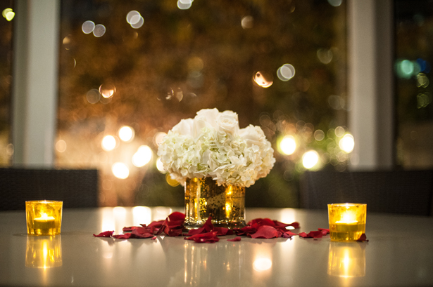 Gold Vase and white flowers wedding centerpiece