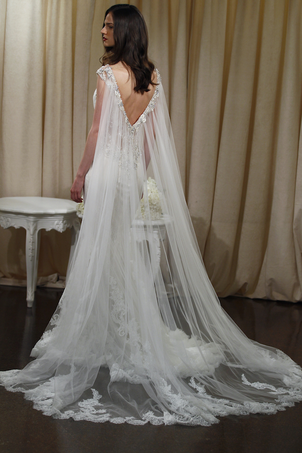 Badgley mischka bride spring 2016 presentation belle the for Wedding dress with a cape