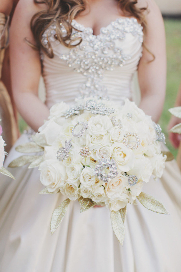White roses and brooches wedding bouquet