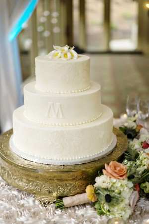 Cream wedding cake -Andie Freeman Photography