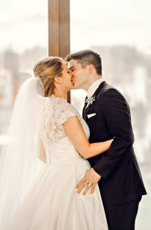 Bride and groom kiss - Melissa Avey Photography