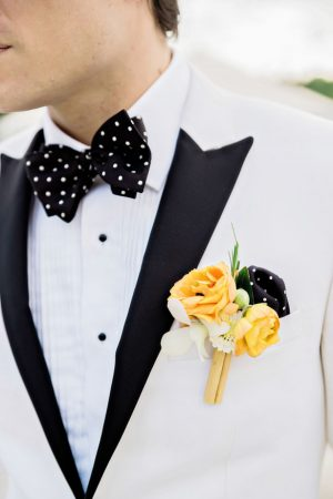 Orange groom boutonniere - Andie Freeman Photography