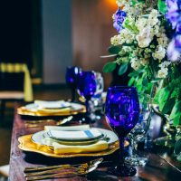 Blue and gold wedding table decor - Derek Halkett Photography
