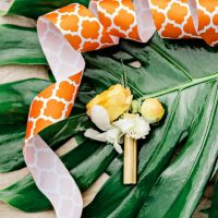 Yellow boutonniere - Andie Freeman Photography