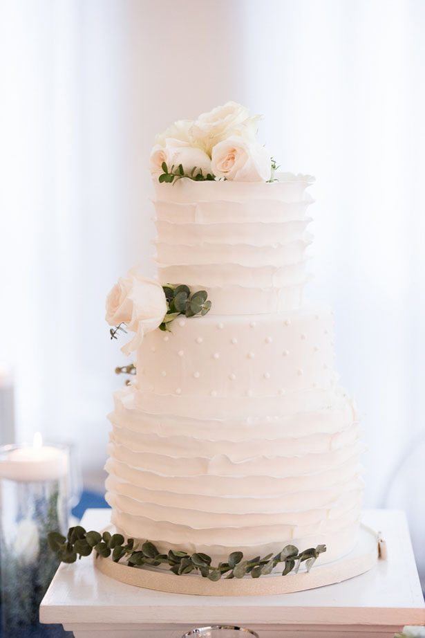 All white wedding cake with greenery foliage detail - Elizabeth Nord Photography