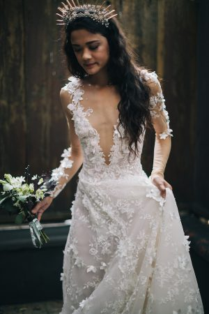 Deep v-neck and lace wedding dress -Erika Layne Photography