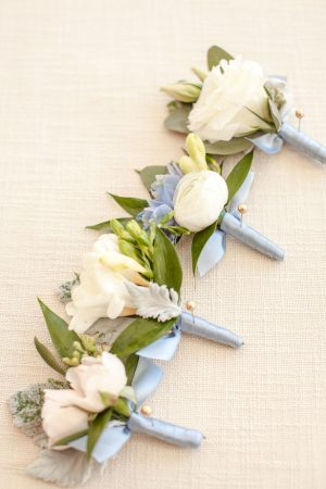 Dusty blue wedding boutonnieres - Anna Holcombe Photography