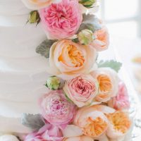 Pink and orange floral wedding cake - Clane Gessel Photography