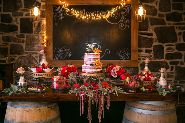 Rustic wedding cake table decor - Aida Malik Photography