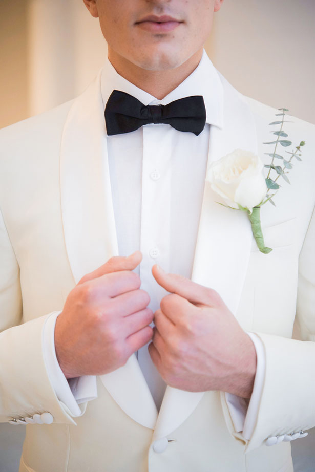 White groom tuxedo with black bow tie - Elizabeth Nord Photography