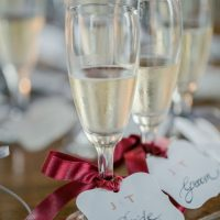 Wine glass wedding escort cards - David Bastianoni