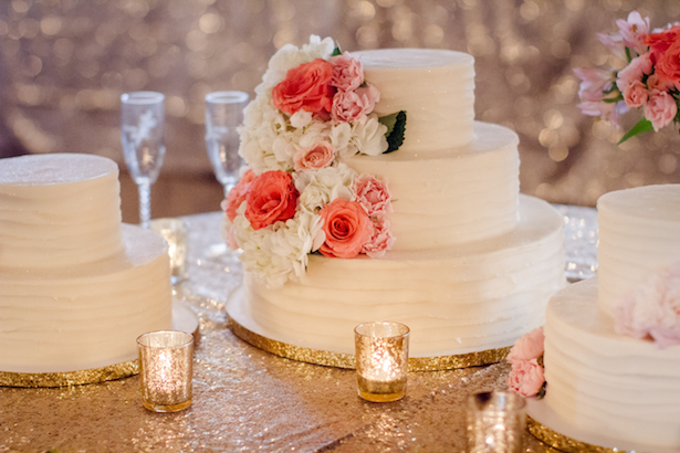 White wedding cake with coral flowers - Freeland Photography