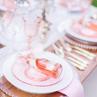 Pink wedding table with Weddding favors - Caroline Ross Photography