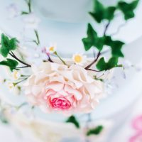 Dusty Blue Wedding cake with pink flowers - Caroline Ross Photography