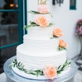 Coral, greenery and white wedding cake - Kiel Rucker Photography
