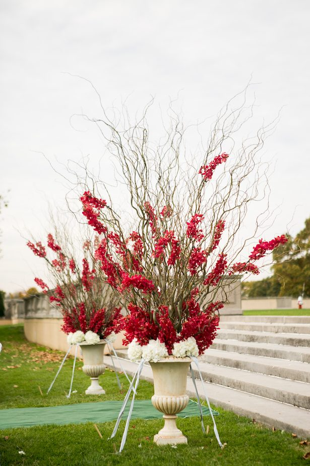 Red wedding ceremony flowers - Cody Raisig Photography