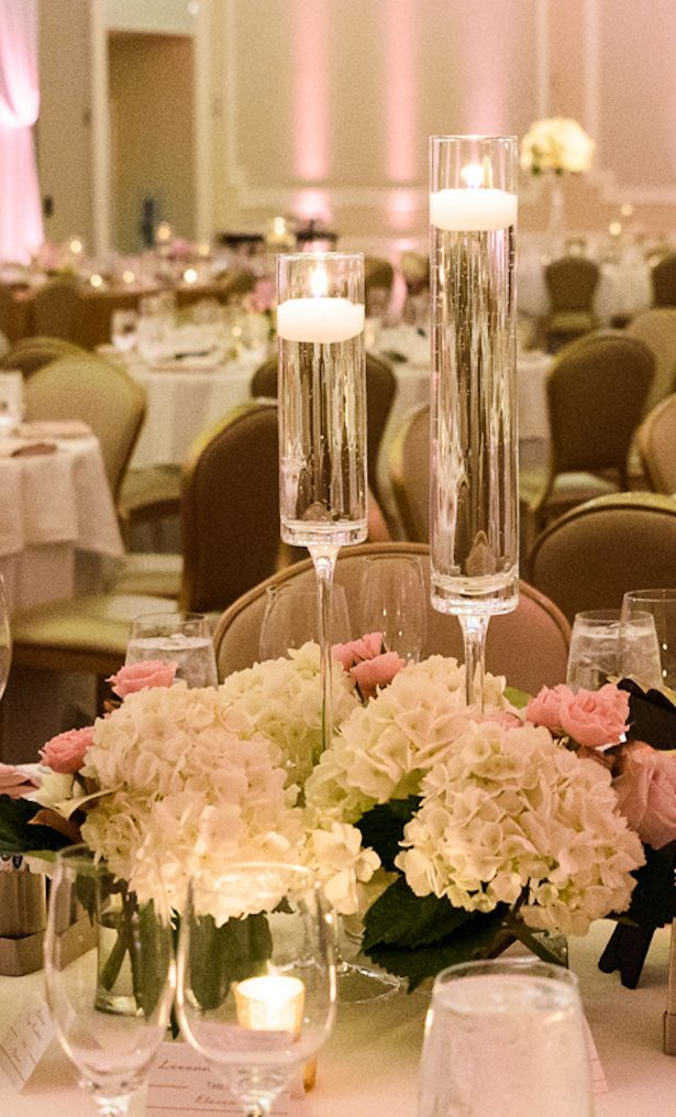 Pink and white wedding centerpiece with candles - Katie Whitcomb Photographers