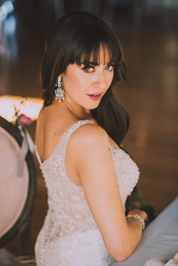 Sophisticated Bride wearing a Mon Cheri Bridals Wedding Dress - Cristina Navarro Photography