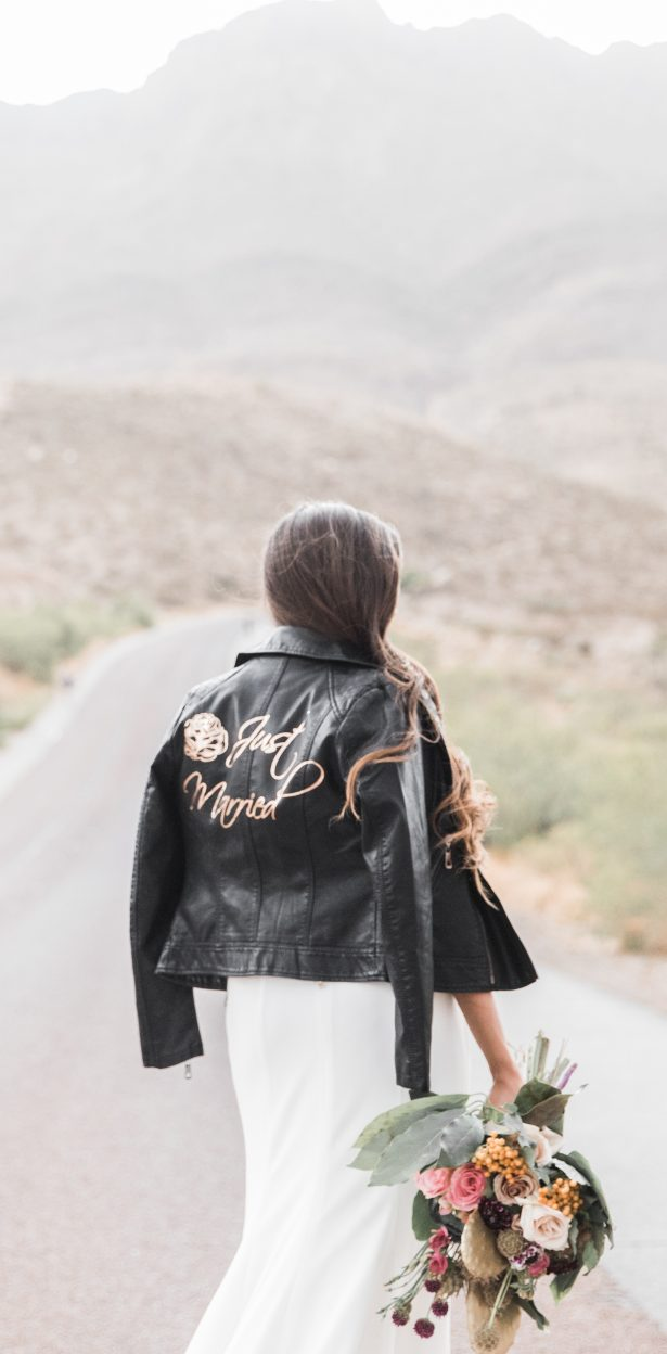 Bride wearing a leather jacket - - Coffee Creative Photography