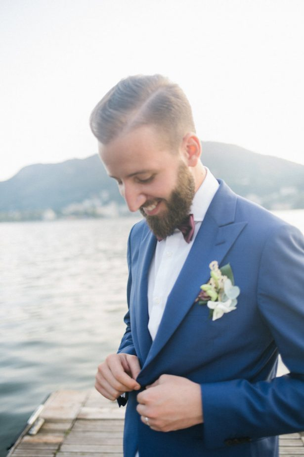 Groom in blue suite and maroon bowtie - Photography: Irene Fucci