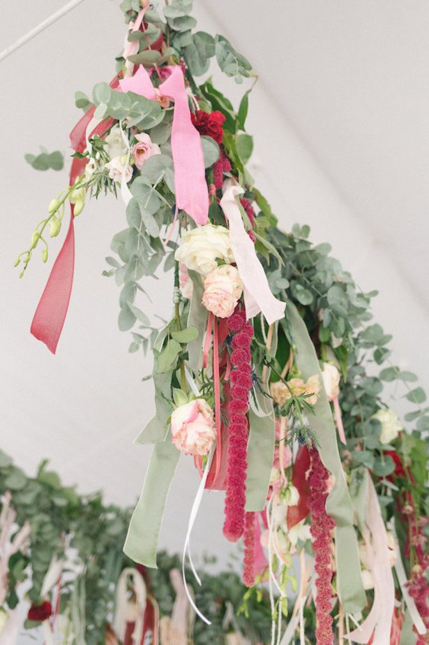 Ribbon and greenery hanging wedding decor - Photography: Irene Fucci