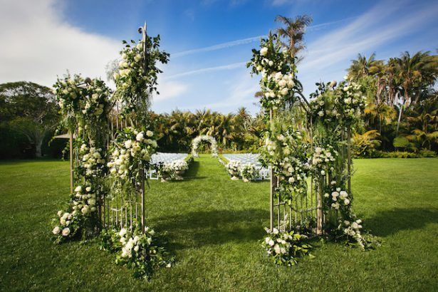 White and greenery outdoor wedding ceremony- Photography: Callaway Gable