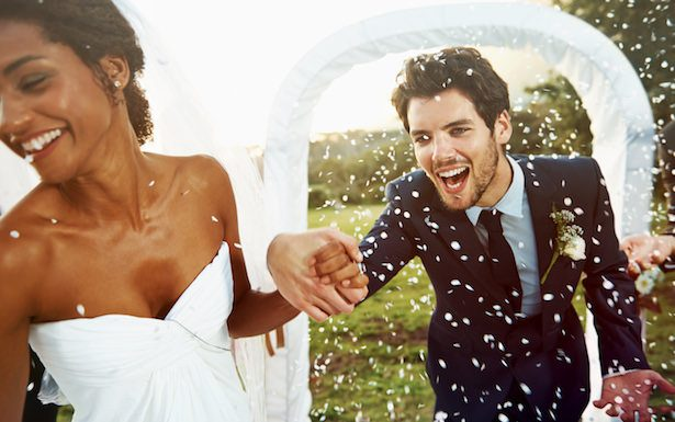 Wedding Photo - Cropped shot of an excited bride pulling her groom