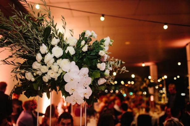 White and greeen wedding centerpiece - Photography: Prue Franzman