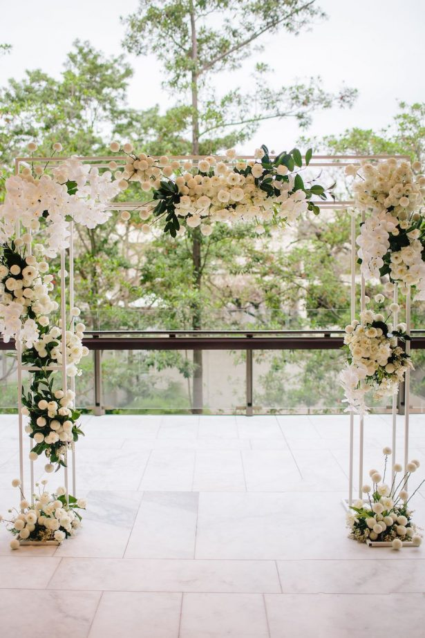 White wedding ceremony arch - Photography: Prue Franzman