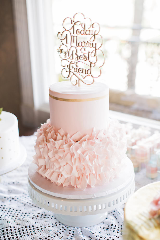 Blush and gold ruffled wedding cake with cake topper - Brooke Images