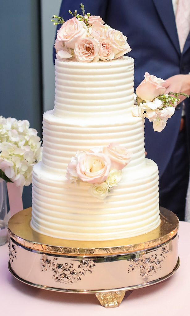 Simple and elegant buttercream wedding cake with flowers - Lifelong Photography Studio