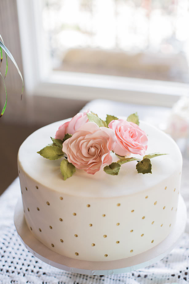 White wedding cake with gold details and flowers - Brooke Images