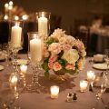 Elegant wedding centerpiece with roses and candles - Wasio Photography