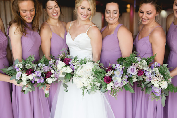 Lilac mismatched long bridesmaid dresses and bouquets - Photography: Rochelle Louise