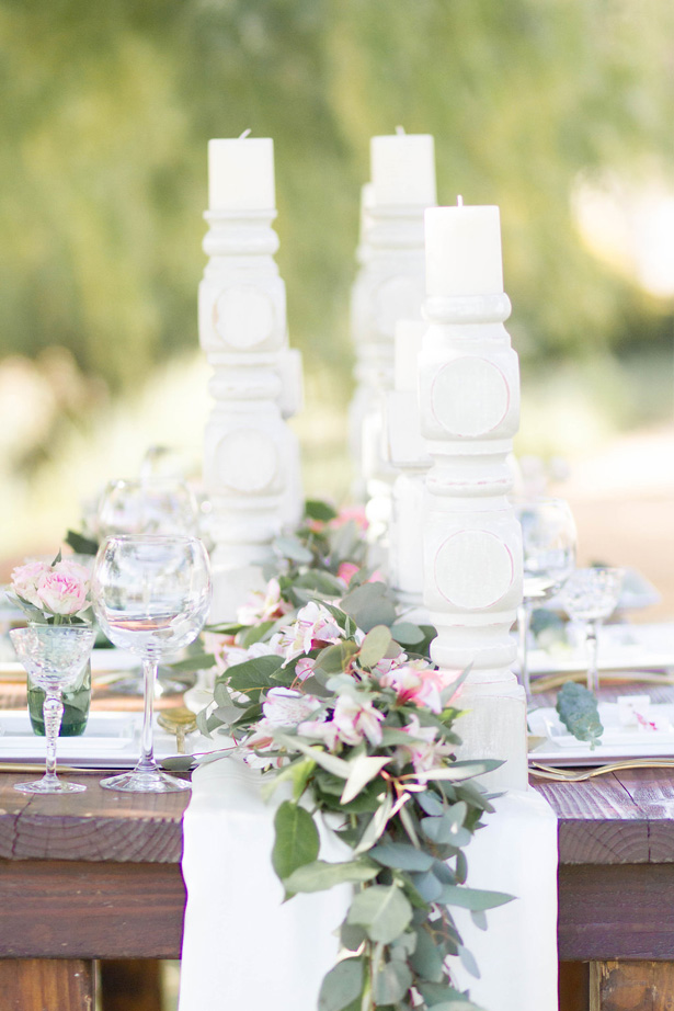 Greenery garland wedding centerpiece with pink flowers- Janita Mestre Photography