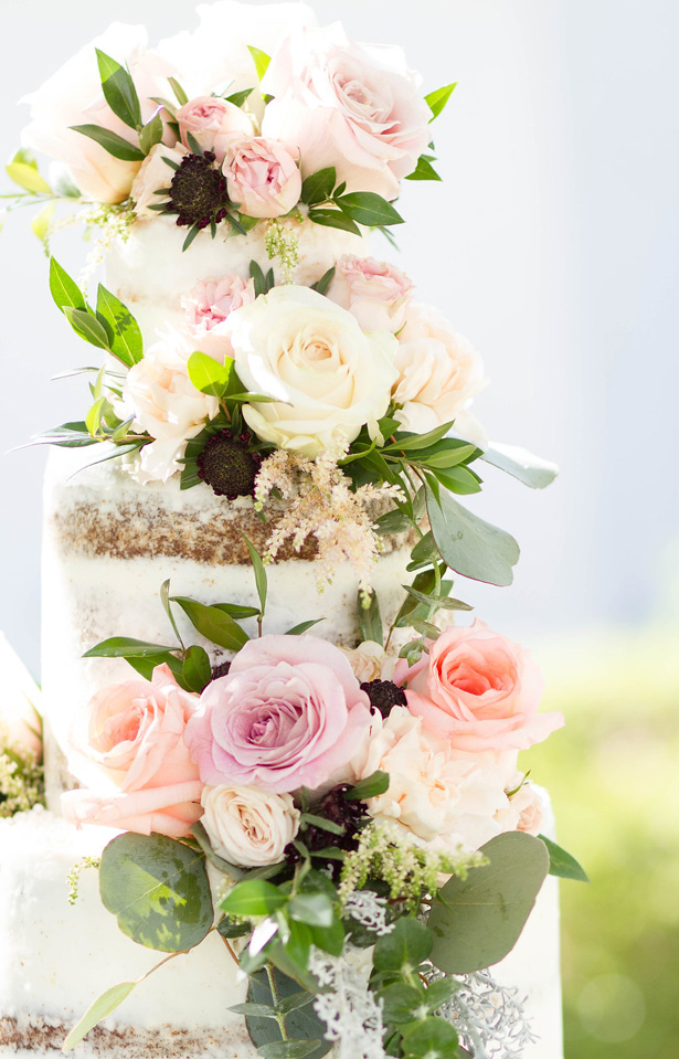 White naked wedding cake with blush roses and flowers - Janita Mestre Photography
