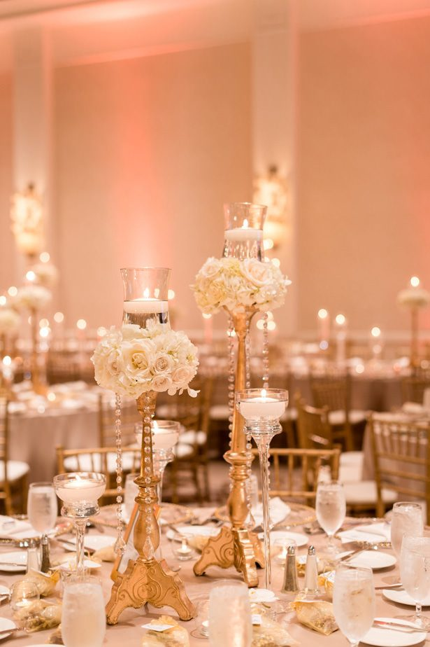Gold Candelabra Tall wedding centerpiece with white flowers - Photographer: Julia Franzosa
