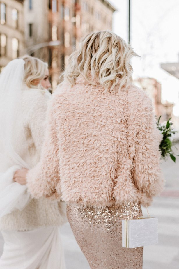 Rose gold long sequin bridesmaid dress and blush winter wedding coatNicole Jansma Photography