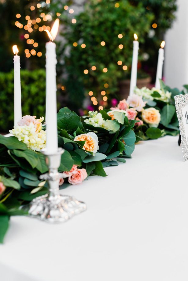 Wedding centerpiece table garland with greenery and roses - M.Hutchison Photography