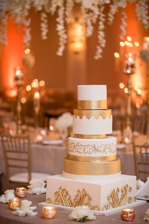 White and gold luxury wedding cake - Photographer: Julia Franzosa