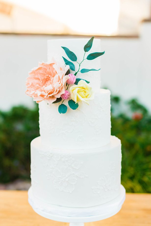 White lace wedding cake with sugar flowers - M.Hutchison Photography