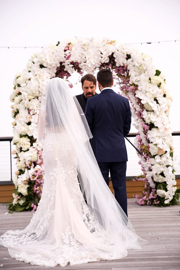 Floral Wedding ceremony arch - Photography: Adam Opris