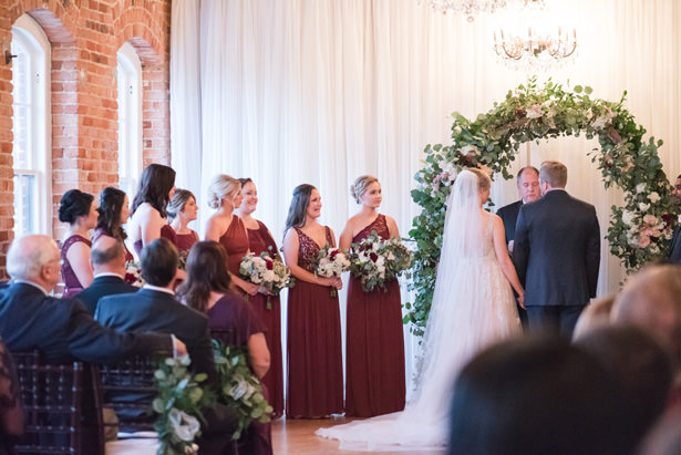 Elegant Drapery At Indoor Ceremony: A Classic Elegant Wedding Overflowing With Rustic Romance