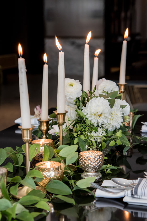 Low white wedding centerpiece with greenery and candles - Photography: Gerber Scarpelli Weddings