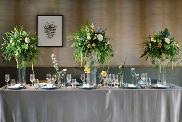 Wedding Tablescape with tall greenery centerpieces - Tell Your Story Photography