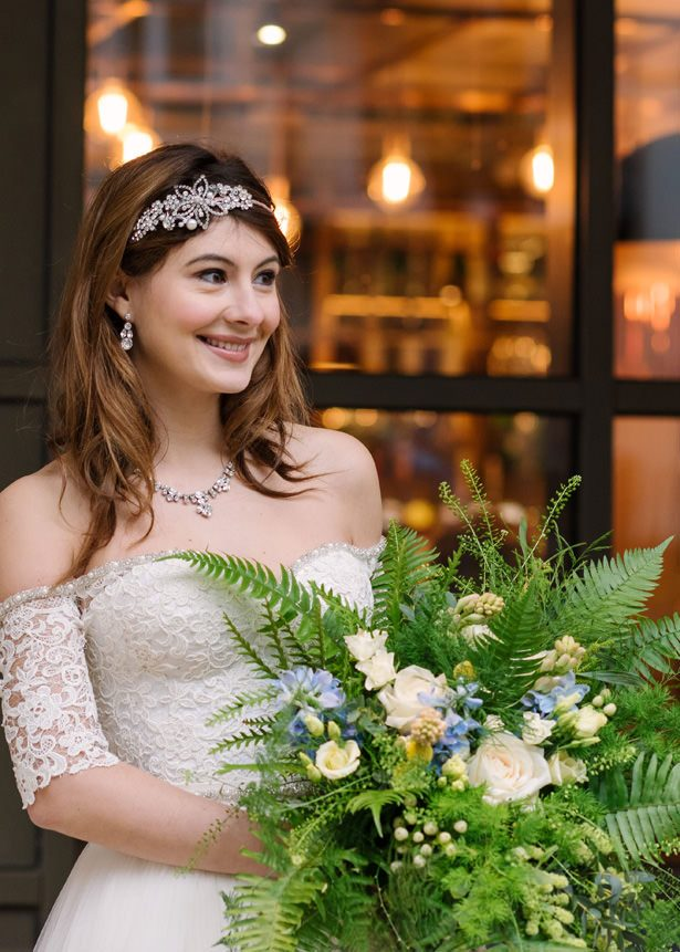 White rose and greenery wedding bouquet - Tell Your Story Photography